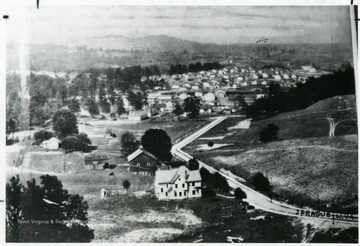 Clusters of miner's houses in the distance at Sprague, W. Va.