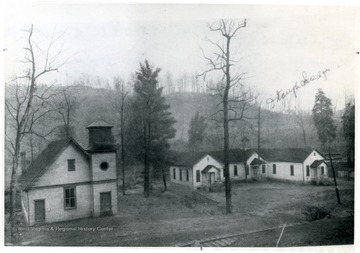 On the right is the MacDonald Presbyterian Church, and on the left is probably a schoolhouse.