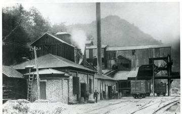 Men stand in front of the tipple and power house at the Great Kanawha Mine, Great Kanawha Colliery Co., Kanawha County.