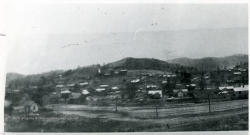 Panoramic view of the town of MacDonald with tipple on the hillside.