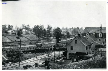 Houses around a railroad in a mining town. Mabscott and Wickham workers were close neighbors.