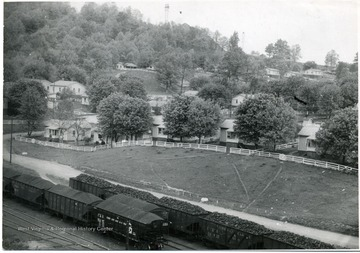 Trains filled with coal file past a group of miners houses in Sprague, W. Va.
