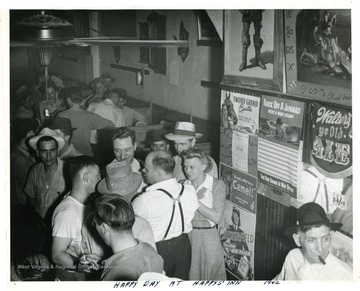 Large crowd in Happy's Inn. 'James Timmis [sic], who was an organizer at Chicago, meat packers [sic].'
