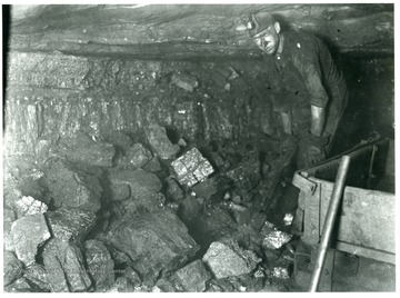 'Coarse Lumpy Coal: This very coarse lumpy mine run coal is the result of proper shooting. The miner is paid on a tonnage basis for loading this coal into mine cars. He is required to watch his coal carefully as he loads it and she that no impurities become mixed with the coal.'