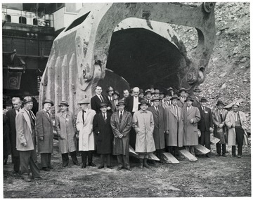 Group portrait of business men in scoop.