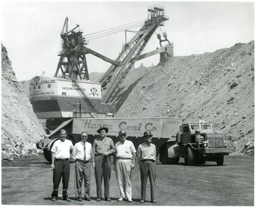Group of men stand near Hanna Coal Co.'s shovel 'The Mountaineer' as well as a Euclid coal truck.