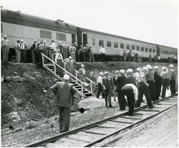 Group of men outside of a New York Central train.
