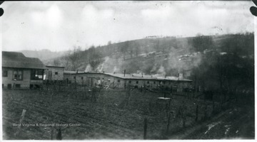 View of barracks with smoke coming from the chimneys.