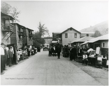 Miners' families with belongings in front of their former houses.