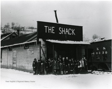 Group in front of the Shack community center on a winter day.