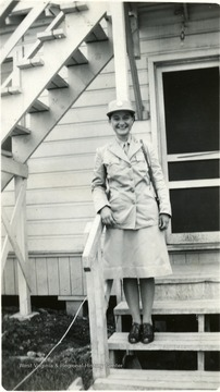 Goldie Zane Brooks standing on steps of barracks in Ft. Oglethorpe.  Director of Settlement House, 1942-1943.