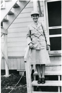Goldie Zane Brooks on steps of barracks in Ft. Oglethorpe. Director of Settlement House 1942-1943.