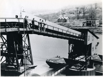 Loading barges for shipment on the Monongalia River. 'For information on the Mountaineer Mining Mission See A&M 2491 (SC).'