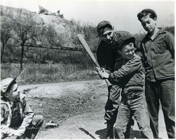 Boys playing baseball. 'For information on the Mountaineer Mining Mission See A & M 2491 (S.C.).'