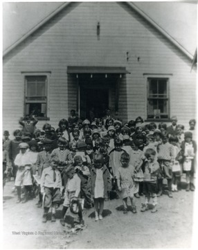 Group portrait of children outside of schoolhouse. 'For information on the Mountaineer Mining Mission See A&M 2491 (S.C.).'