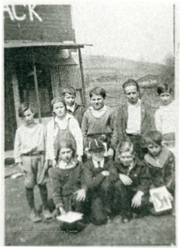 Group portrait of boys in front of 'The Shack'. 'For information on the Mountaineer Mining Mission See A&M 2491 (S.C.).'