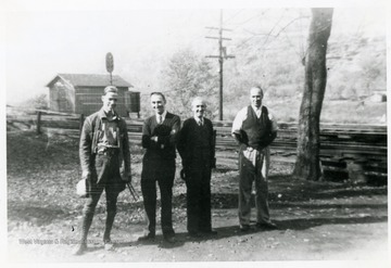 Group portrait from Left to Right: Charlie Smith, Mr. McGuire, Mr. Guinn, Lundy E. Meadows at Fire Creek.