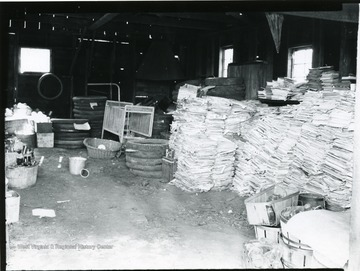 Piles of papers, tires and other materials inside a building at Scott's Run.