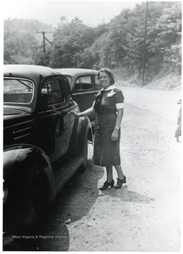 View of Nurse Marie Isselstein entering a car.