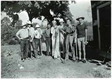Group of men before garden work.