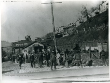 Works Progress Administration workers stand near the tipple and railroad tracks at Pursglove, W. Va. 'For more information on the Mountaineer Mining Mission see A&M 2491 S.C.'