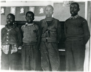 Four African-American students singing at Osage School. 'For more information on Mountaineer Mining Mission see A&M 2491 (S.C.)'L to R: John Boyd, unidentified, likely Tim Johnson's brother, and Tim Johnson