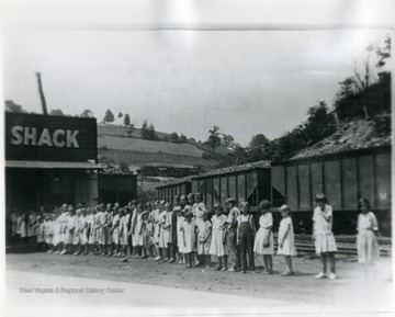 Children standing in front of the Shack at Pursglove, W. Va.; 'For more information on Mountaineer Mining Mission see A&M 2491 (S.C.)'