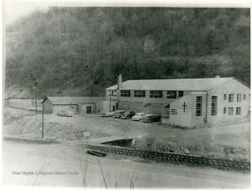 Cars parked outside the Miners Memorial Center. 'For more information on Mountaineer Mining Mission see A&M 2491 (S.C.)'