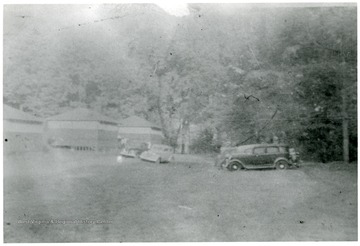 View of camp facilities and cars parked nearby.
