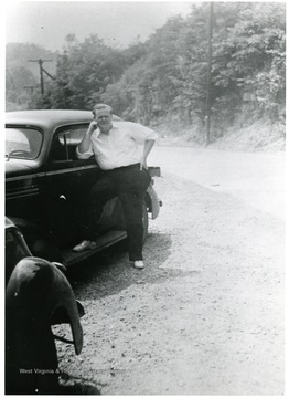 Alton Mackay standing next to a car.