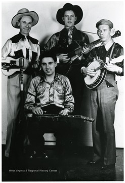 Group of four country musicians.