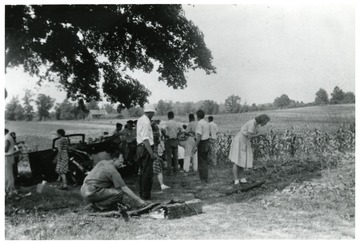 Group of people getting ready to harvest a garden.