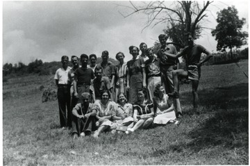 Group portrait of friends in a field.  Possibly American Friends Service Committee workers.