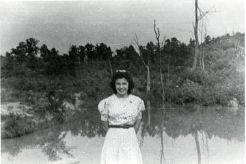 Viola Trubee standing next to water.