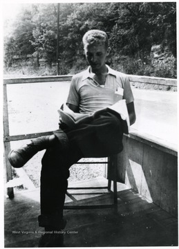 Bill Ellis reading a book.