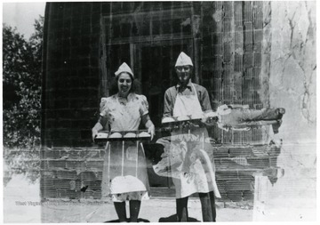 Two bakers stop for a picture.  Possibly American Friends Service Committee members.