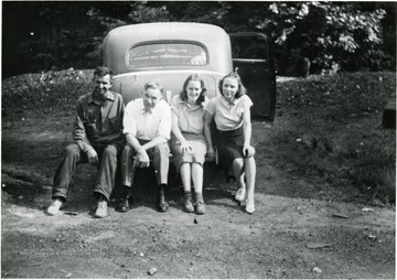 Foster Molisee (left), Bushrod Grimes (2nd from left), Unknown Girl, Miss Burge (Right.)