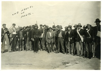 Group portrait of men standing with their ammunitions.
