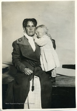Miner's wife and child posing for a photograph.