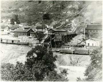 Mine tipple surrounded by other mine buildings.