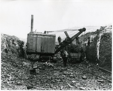 Marion Shovel Model 28 during strip mining.  Donkey is pulling a cart.