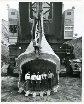 Visitors and workers standing inside of a coal shovel, possibly The Tiger.