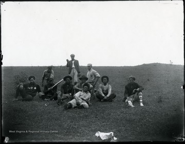African-American baseball players of the Red Star team pose for a team photograph. They played for a community just down Dunloup Creek from Glen Jean. Trevey took this picture about 1915.