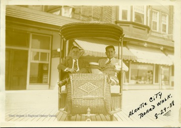 Joe Ozanic (on right) and another man sitting in a cart at the Atlantic City Boardwalk. Joseph Ozanic was a Progressive Mine Workers of America Activist and Officer.
