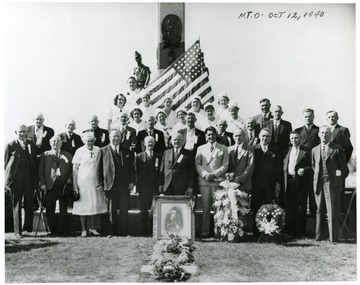 Ceremony at Miners Cemetary, Mt. Olive, Illinois.  First row, left to right 1)- 4)Unknown; 5)August Schoppman, Mayor of Mt. Olive; 6)William Green, AFL President; 7)Joe Ozanic, PMW President; 8)Bill Kack, previous president, PMW Dist. 1; 9)John McCann, board member, PMA Dist. 1; 10)Unknown 11)Bill Compton, Vice Pres. Dist. 1.;  2nd row 1)Unknown; 2)Mike Engleman, Mt. Olive Miner; 3)George Simbger, miner and Virden Massacre Veteran; 4)Unknown; 5)Unknown; 6)Hansen, Mt. Olive miner; 7)Matt Yurkovich, Mt. Olive miner; 8)Nick Piluga, Mt. Olive miner; 9 Bush Miller, Mt. Olive miner.