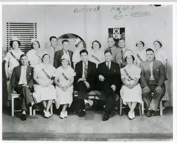 A group portrait of the officers of the Progressive Mine Workers of America and Women's Auxiliary.