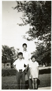 Joe Ozanic as a young man and two other children pose for a picture.