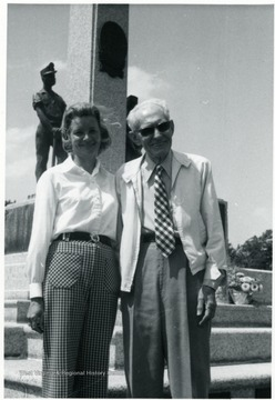 Couple standing in front of a monument at the miner's cemetery.