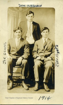 Group portrait of Joe Ozanic (right), Sam Yurkovich (middle, standing), and John Byots (left).