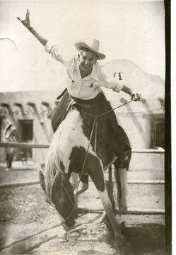 Joe Ozanic leans forward with his arms extended on a pony at Lookout Mountain near Denver, Colorado.